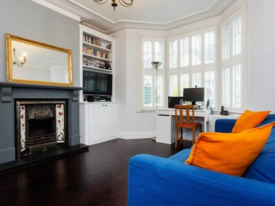 Photo for Delightful English home with lovely fireplace and garden in Wimbledon (Veeve)