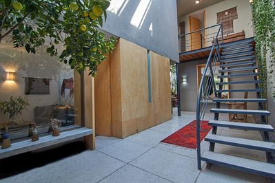 Entryway with 30' high glass- covered ceiling and an orange tree!