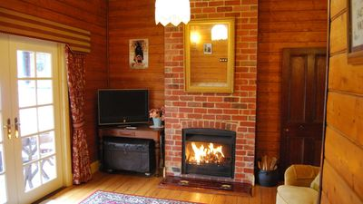 Kelly House Lounge with open fire place.