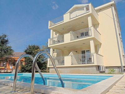 Photo for Lovely sunny apartment - outdoor pool, private parking, barbecue area, terrace