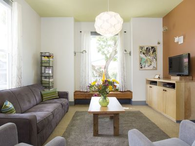 Comfortable large sitting area with lots of natural light. TV, cable and wifi!