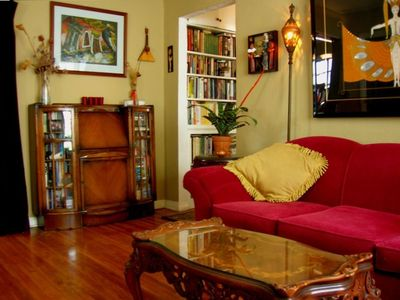 Living Room with Antiques, Deco Art, Bookcases and Secretary Desk