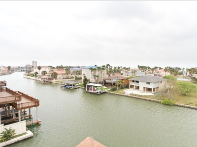 Photo for Channel Front Condo with Boat Slip, Infinity Pool & Hot Tub! Great Location!