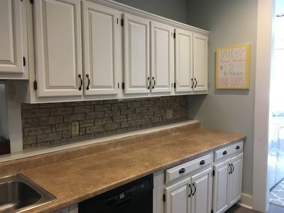 Kitchen includes all the essentials including a dishwasher & coffee maker.