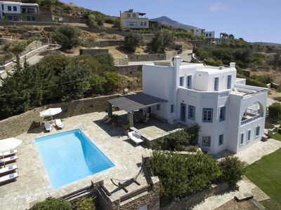 Photo for Superior seafront retreat with private pool, garden and exceptional sunset views