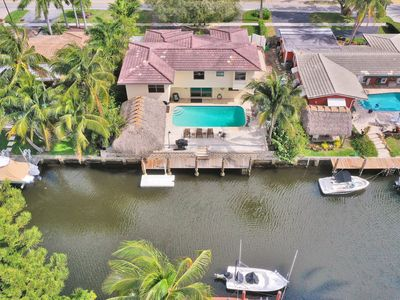 Photo for Luxury 5-bedroom waterfront home with heated pool!