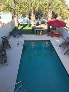 Beautiful large backyard patio with grilling area and fire pit.