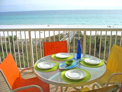 Eat out on the balcony of our ocean front condo at our colorful setting for 4.
