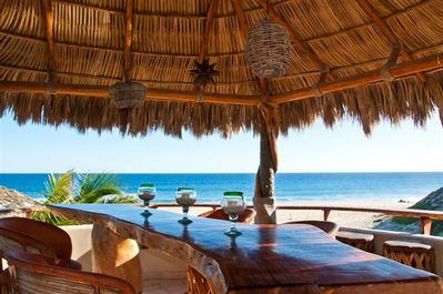Enjoy the Breeze under the Palapa at the Outside Bar