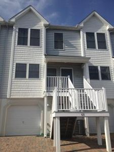 View from front, parking in front of garage and stairs