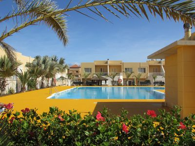 Gated complex with beautiful pool and gardens