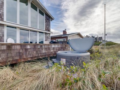 Photo for Modern, dog-friendly beach home w/ private hot tub and sweeping oceanfront views