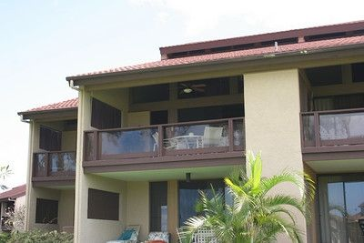 Upstairs end unit with two lanai's overlooking course