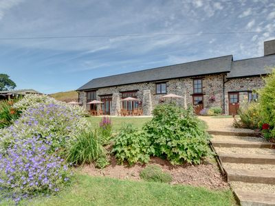 Photo for Lovely apartment in converted, stone barn located in Tiverton