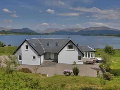 Photo for Luxury waterfront property with outdoor hot tub on shore of Scottish sea Loch.