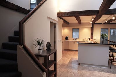 Stair access to top floor, skylights and modern lights, minimalistic feel.