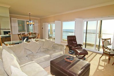 Open Doors, Open Ocean Views - living room and dining space with beach view