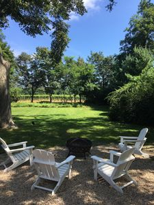 Lounge chairs and firepit overlooking the vineyard