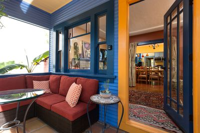 Sunny front porch with comfy seating - perfect for eating breakfast, napping...