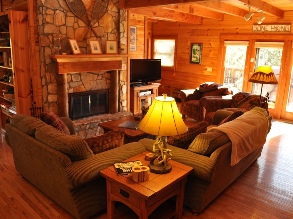 main living room with fireplace and flat screen alpine escape cabin