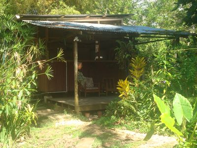 Photo for Caribbeanstyle wooden house in lush garden,150m from the beach