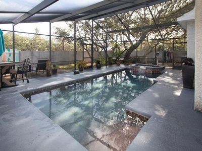 Photo for Heated screened in Pool and hot tub,  Large Patios, Golf Cart & Open floor plan