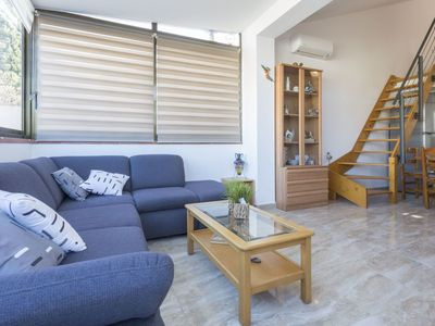 Photo for Cosy apartment for 4 people with A/C, WIFI, pets allowed and parking