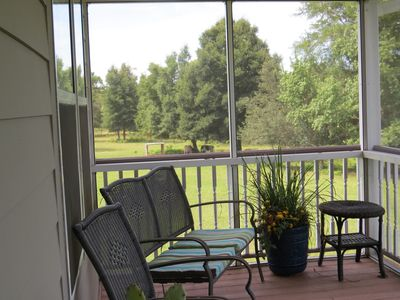 Screened porch overlooks cattle pasture.  Great place for morning coffee.