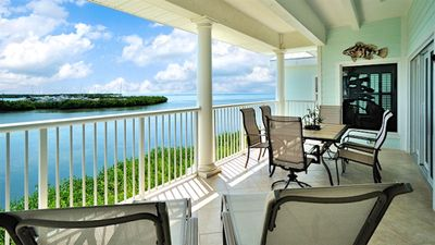 Your balcony looks out on the Atlantic Ocean and the nearby marina...