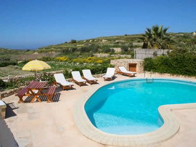 Photo for 3BR farmhouse-turned-villa with great pool, all modern facilities and Wi-Fi, close to the beach
