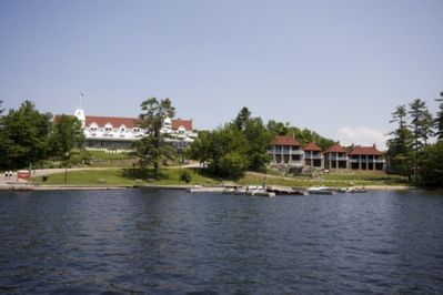 View from Lake Rosseau showing cottage -first building on the left next to hotel.