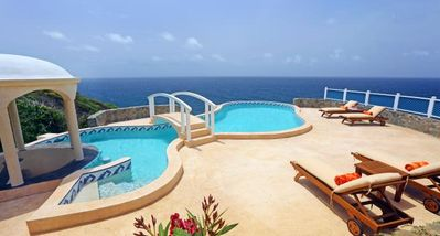 Photo for AVAILABLE NEW YEARS!!! Mesmerizing Ocean Views, Pool, Cap Estate, AC, Free Wifi, Maid