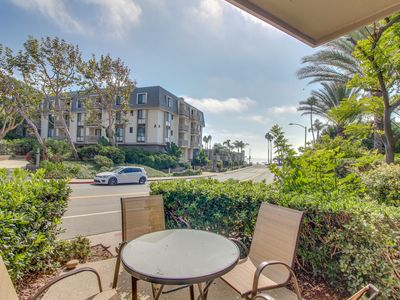Photo for NEW LISTING! Ground floor condo by beach w/ putting green, shared pool, hot tub