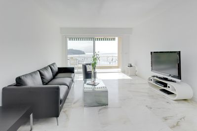 Contemporary living room with access to spacious dining balcony