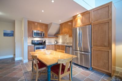 New open kitchen, stainless steel appliances, oak cabinets and granite counters