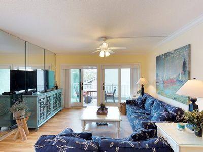 Photo for Waterfront resort retreat w/ a covered balcony & access to shared pool & hot tub
