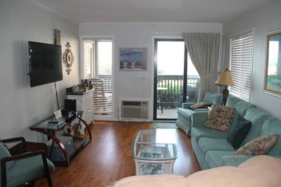 Bright and updated living area with walk out balcony and sitting area.