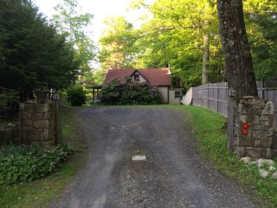 View as you drive up.  The house is on the left behind the trees