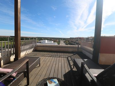 Photo for Penthouse with Amazing Panoramic Golf and Sea Views- Watch the Sunset & relax