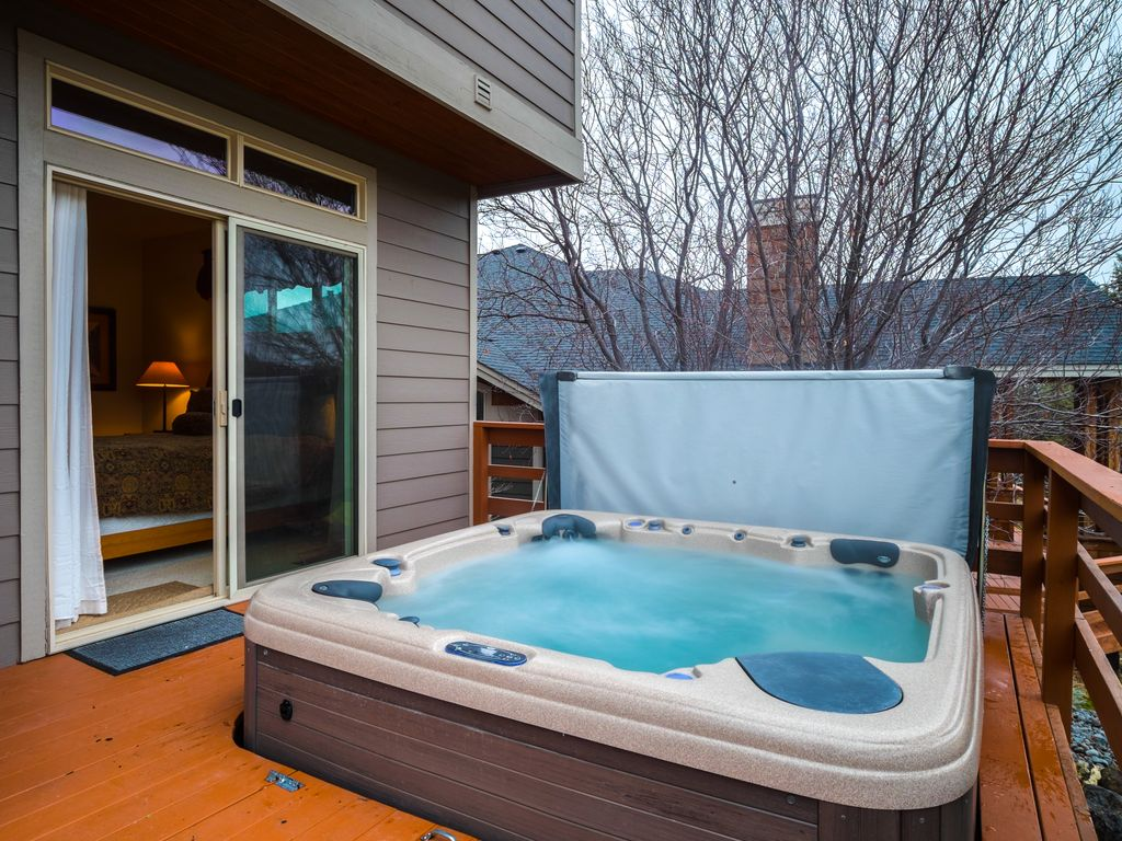 Enjoy private hot tub, shared pool, expansive deck w/views of Ridge ...