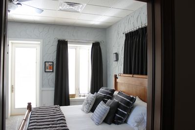 Master bedroom with a view of the Mississippi River and Historical District
