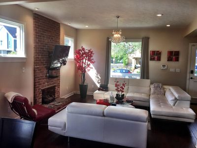 Sunny living room to accommodate a large group in beautiful upscale neighborhood