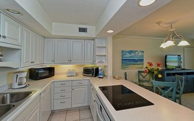 Photo for Enjoy the balmy Gulf breezes in this corner end unit right on the beach!