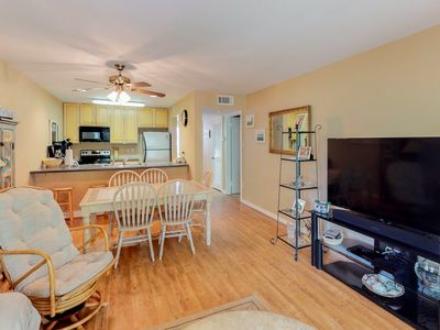 Photo for Second-floor condo with access to shared golf course, pool, and tennis courts