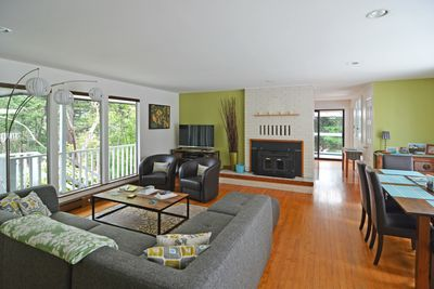 Simple sophistication abounds in this home.  Here you can see the view of the living room fireplace and open living area.