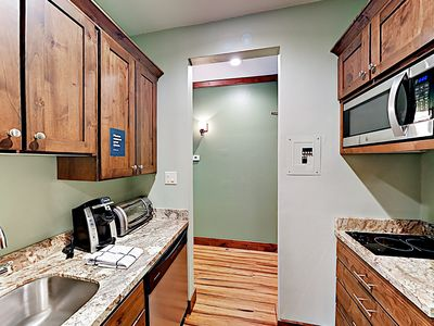 Kitchenette - The spacious and well-equipped kitchenette features a mini-fridge, 2-burner hot plate, and an array of cookware and gadgets.
