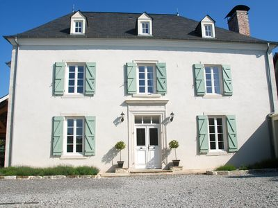 Photo for An elegant and fully modernised Maison de Maitre with heated pool and tennis court.