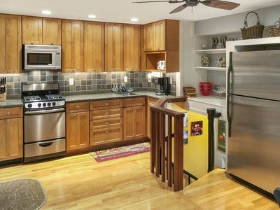 Fully stocked kitchen with stainless steel appliances, + granite countertop