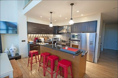 Bright, modern kitchen, with place settings for 16+.