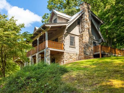 Photo for Charming 4BR Mountain Retreat Tucked Amongst the Trees w/ Spacious Deck